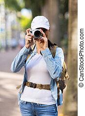 tourist taking photos in downtown