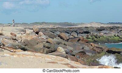Tourist Taking Photos on Stone Breakwater in Sri Lanka -...