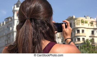 Tourist Taking Photos Using Digital Camera
