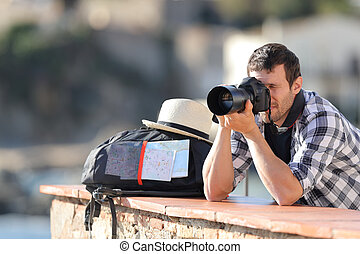 Tourist taking photos with a digital camera on vacation