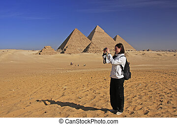 Tourist taking picture at Great Pyramids of Giza, Cairo,...