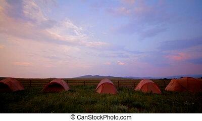 tourist tent on nature sunset time lapse