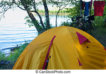tourist tent on the shore of the pond, yellow tent on the shore of the lake, vishtynets lake