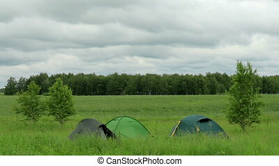 Tourist tents. Movement of clouds over a dirt road. Ishimsky...