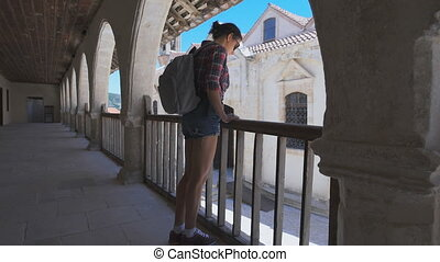 Tourist travels in Europe, sightseeing tour. A woman with backpack.