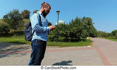 Tourist using smartphone for navigation. Man looking for an...