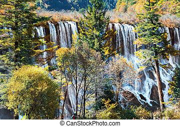 Tourist visit the Nuorilang Waterfall in Jiuzhaigou National Par
