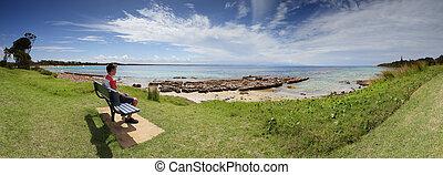 Tourist visitor admiring the views Currarong Beach Australia...