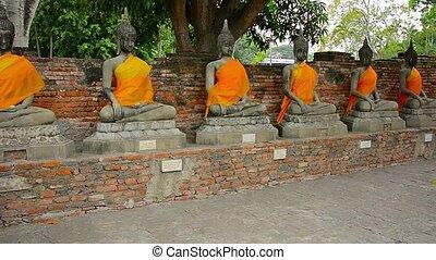 Tourist Visits Ancient Buddha Statues at Wat Yai Chai...