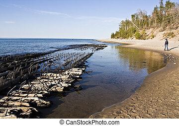 Tourist walking on the beach