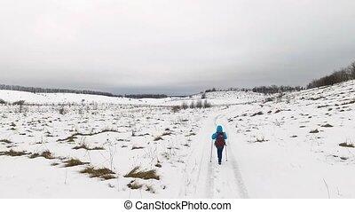 Tourist walks in snow