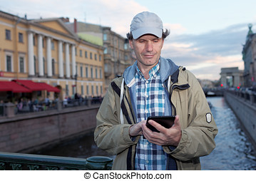 Tourist with a tablet in St. Petersburg, Russia