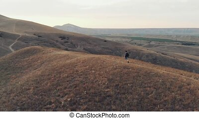 Tourist with backpack hiking in mountians - Man traveling...