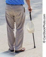 tourist with cap and walking stick
