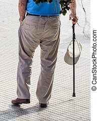 tourist with hat and walking stick