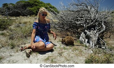 Tourist with two Quokka