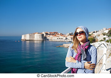 Tourist woman against old town of Dubrovnik
