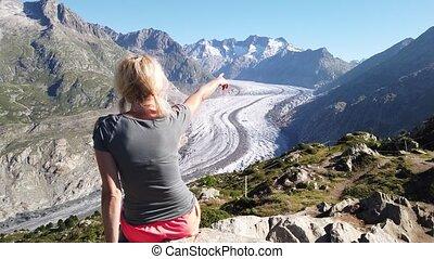 Tourist woman at Alpine Glacier - Aletsch Glacier from ...