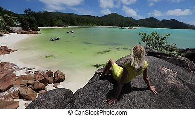 Tourist woman at Cote d'Or - Panorama of Praslin,...