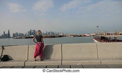 Tourist woman at Doha Corniche