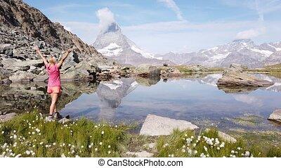 Tourist woman at Matterhorn on Riffelsee Lake - Mount ...