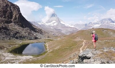 Tourist woman at Matterhorn on Riffelsee Lake - Tourist ...