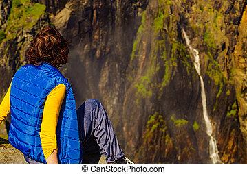 Tourist woman at Voringsfossen waterfall Norway