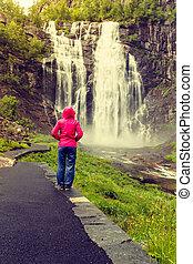 Tourist woman by Skjervsfossen Waterfall - Norway