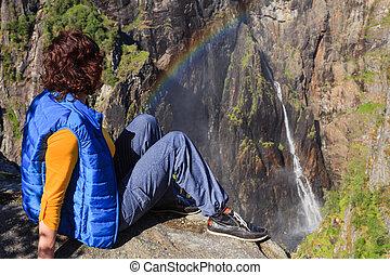 Tourist woman by Voringsfossen waterfall, Norway