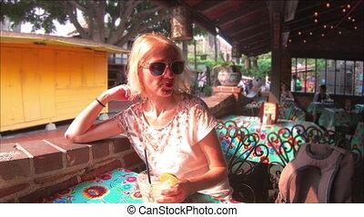 Tourist woman drinking Margarita - Happy caucasian woman...
