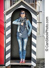 Tourist woman imitates a soldier on guard