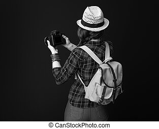 tourist woman on background with DSLR camera taking photo
