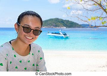 Tourist woman on the beach at Similan islands, Thailand