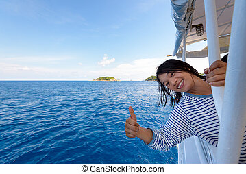 Tourist woman traveling by boat