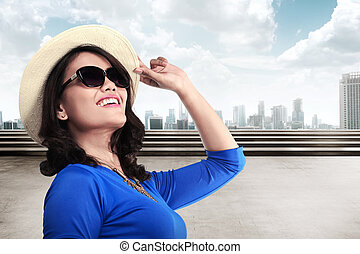 ab5ddabd Senior tourist wearing funny hat sunglasses. Smiling middle age ...