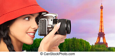 Tourist woman with a camera.