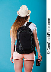 Tourist woman with backpack rear view