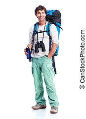 Tourist. Young man hiking.