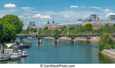 Touristic boat passes below Pont des Arts, on boat station...
