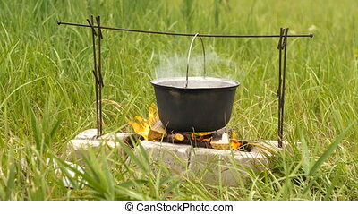 touristic cauldron on a fire - Cooking with touristic...