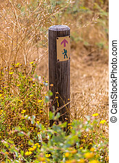 sign on a wooden post