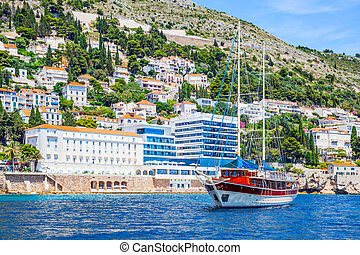 Touristic ship and hotels on shore in Dubrovnik in Croatia