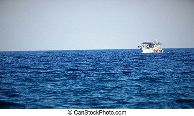 Touristic small ship in sea 4k