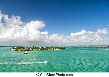touristic yachts floating by green island at Key West, ...