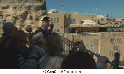 tourists 1 - Tourists look at the Wailing Wall