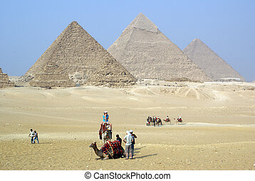 Tourists and piramids - Tourists, camels and piramids in...