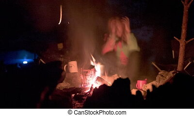 Tourists around the campfire at night. Olkhon Island Lake...