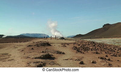 tourists at fumaroles area in icela