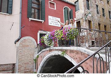 Tourists at Ponte de la Chiesa, Venice, Italy