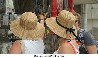 Tourists at street shop